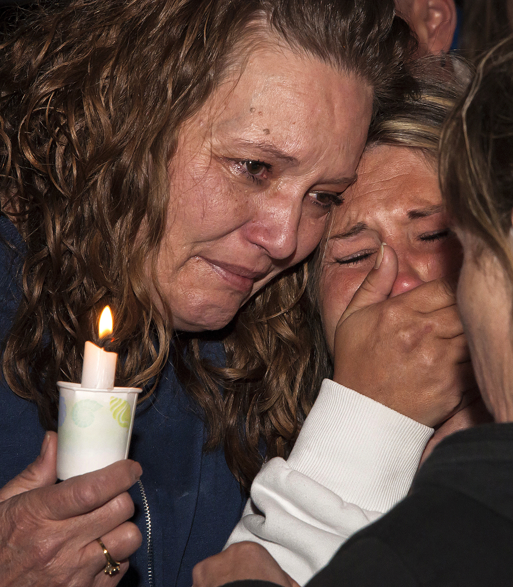 Michael Mangum  |  The Salt Lake Tribune  |  Debbie Evans, close friend of Ronnie Lee Gardner, comforts Brandi, Gardners daughter, late Thursday night, June 17, 2010, at a protest of Ronnie Lee Gardners execution in Draper, Utah.