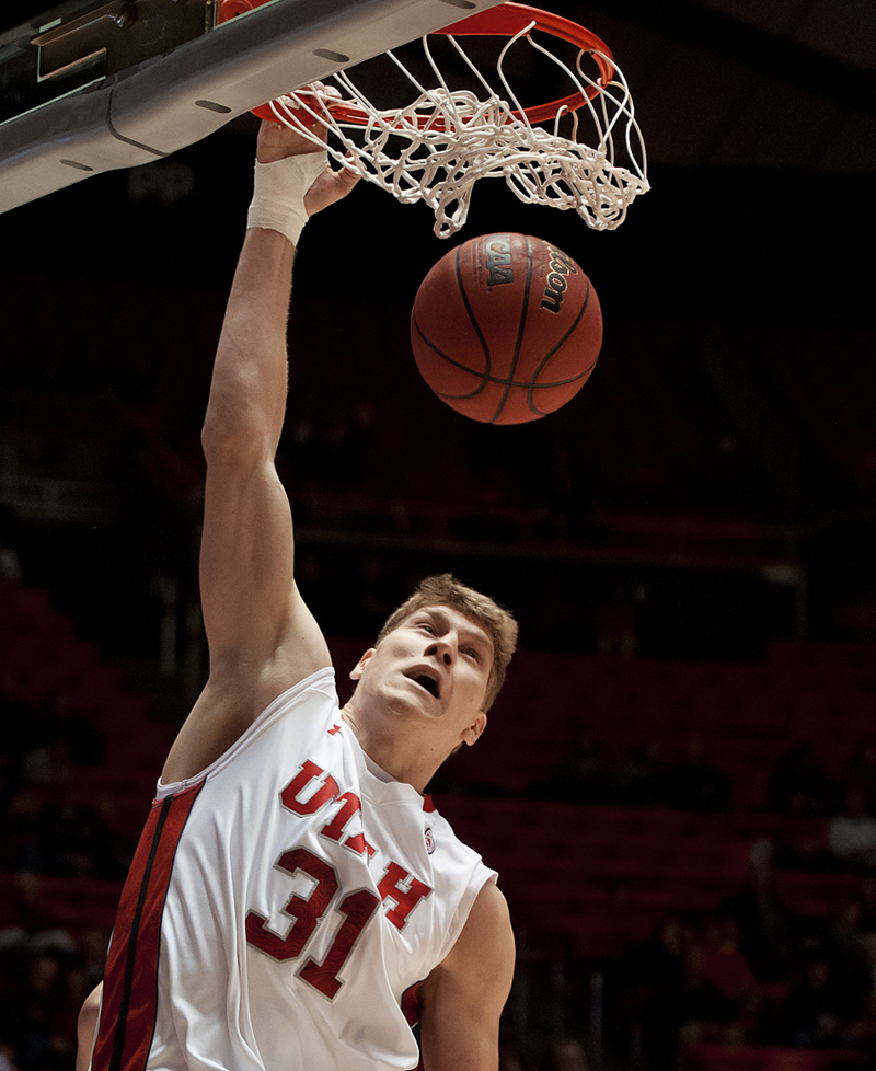 Michael Mangum  |  Special to the Tribune | Utah center Dallin Bachynski (31) dunks home 2 points during their game against the Willamette Bearcats at the Huntsman Center on Friday, November 9, 2012. Utah led 52-22 after the first half.