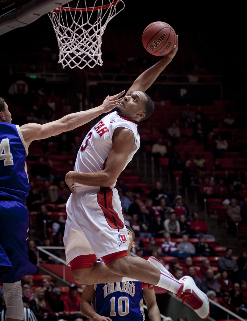 Utah Utes guard JUSTIN SEYMOUR (3) flies up for a dunk attempt in front of College of Idaho guard SYDNEY DONALDSON (14) during their game at the Jon M. Huntsman Center in Salt Lake City, UT on Friday, December 28, 2012. Utah beat College of Idaho 72-38. | Photo by Michael Mangum