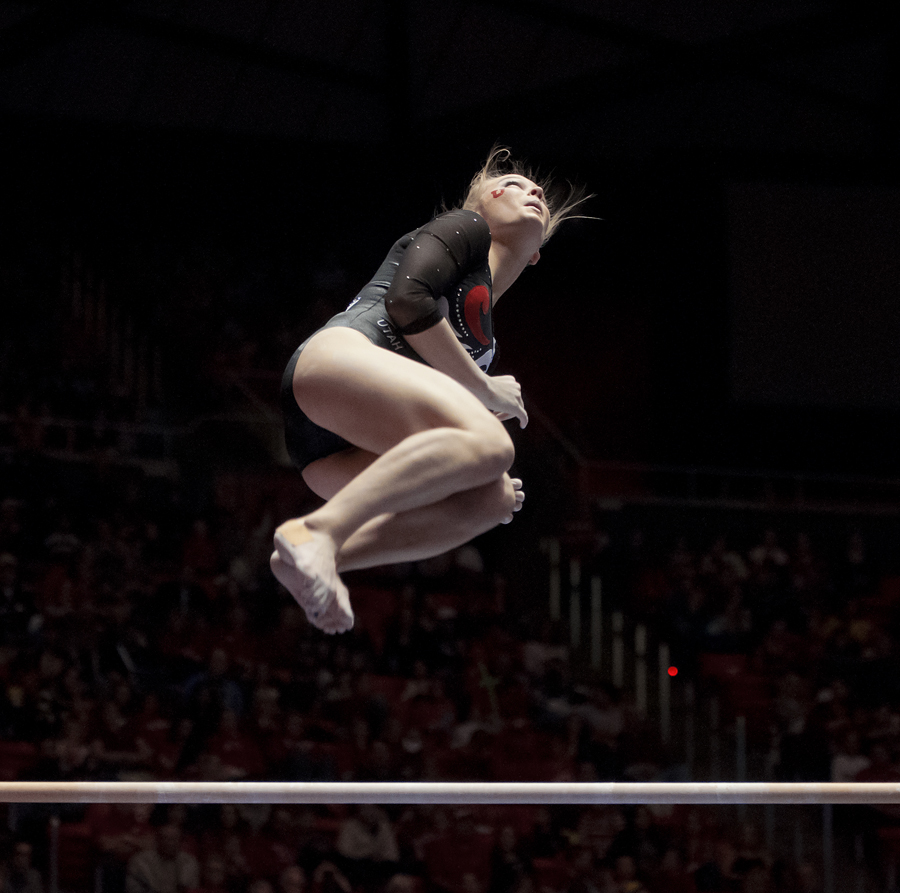 Utah sophomore GEORGIA DABRITZ dismounts the uneven bars during their meet at the Jon M. Huntsman Center in Salt Lake City on Saturday, January 19, 2013. Utah won with a score of 196.95 over 2nd-place Oregon State (195.95), 3rd-place West Virginia (192.125) and 4th-place Southern Utah (191.05). | Photo by Michael Mangum