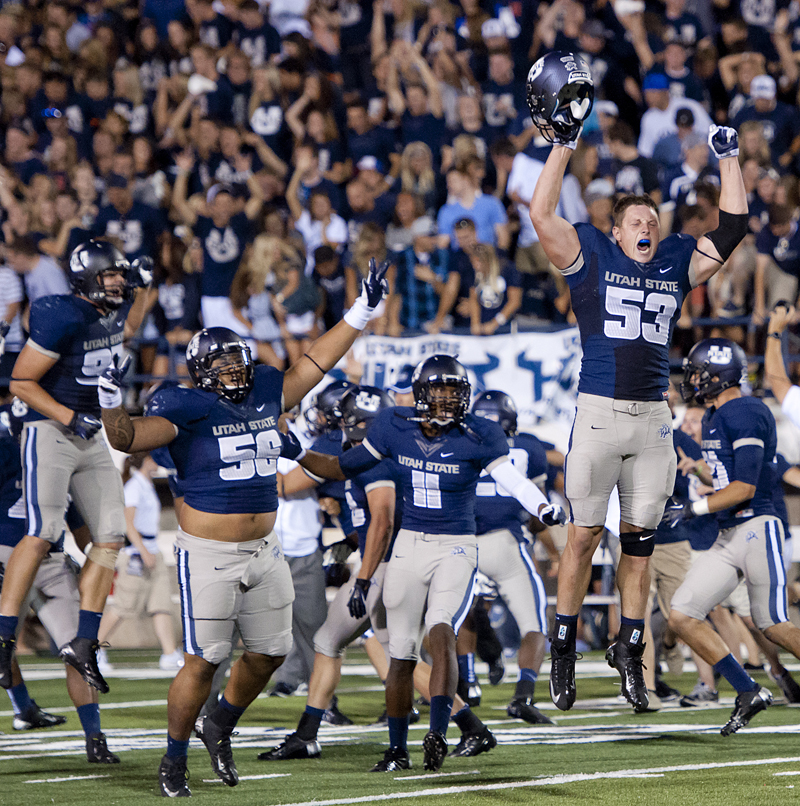 Utah State Aggie players celebrate their overtime victory against the Utah Utes at Romney Stadium in Logan, UT on Friday, September 7, 2012. Utah State beat Utah 27-20 in overtime. Utah State went on to have the most successful season in school history with an 11-2 record, including a top-25 BCS ranking and a bowl win over Toledo. Photo by Michael Mangum