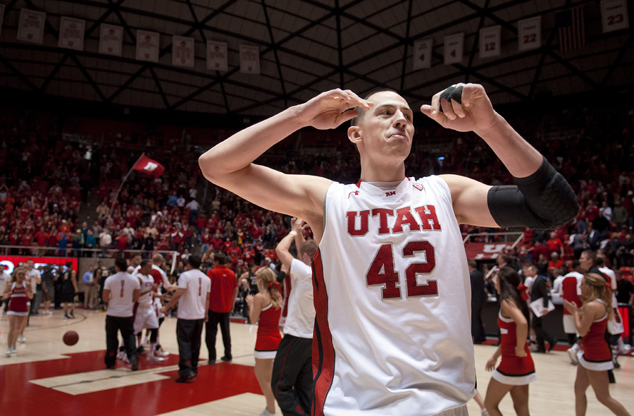 Utah Utes center JASON WASHBURN celebrates a close victory over the Colorado Buffaloes aat the Jon M. Huntsman Center in Salt Lake City, UT on Saturday, February 2, 2013. Utah, who led by as many as 22 points in the second half, defeated Colorado 58-55. | Photo by Michael Mangum