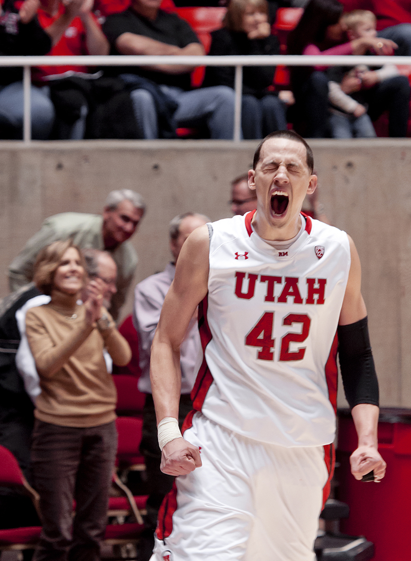 Utah Utes center JASON WASHBURN (42) celebrates his teams victory over the Oregon State Beavers at the Jon M. Huntsman Center in Salt Lake City, UT on Thursday, March 7, 2013. Washburn hit the 1000 point career milestone at Utah on the night, scoring 15 points as the Utes defeated the Beavers 72-61. | Photo by Michael Mangum