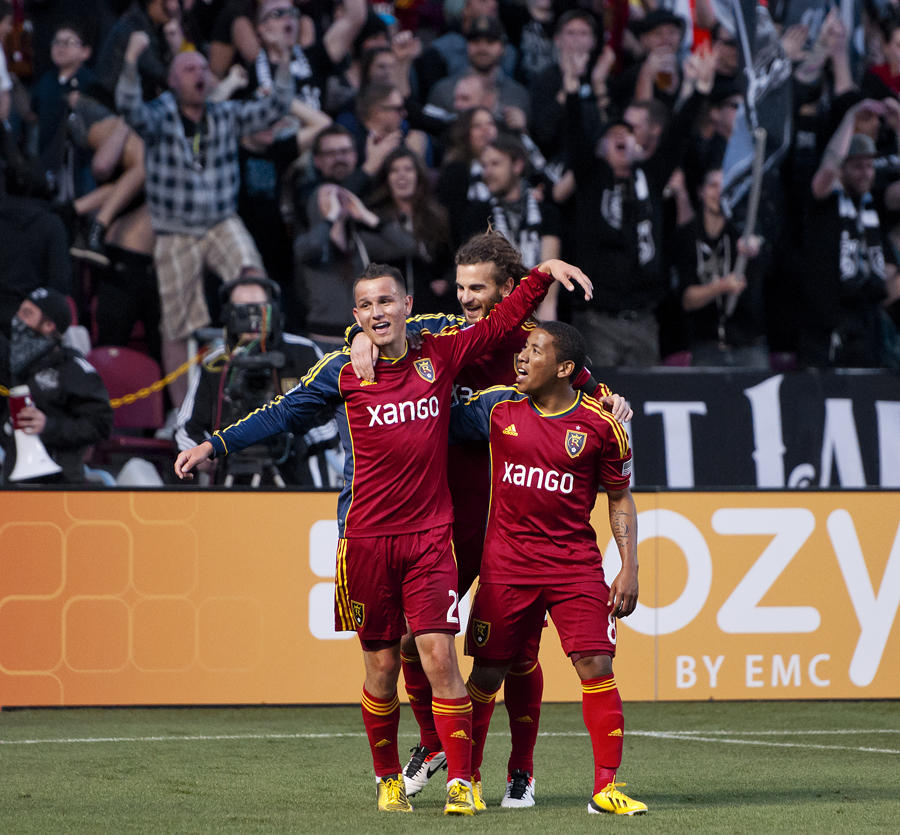 Real Salt Lake midfielder LUIS GIL (21), celebrates his first-half goal with teammates KYLE BECKERMAN, rear, and JOAO PLATA, right, during their match against Seattle Sounders FC at Rio Tinto Stadium in Sandy, UT on Saturday, March 30, 2013. Real Salt Lake won 2-1.