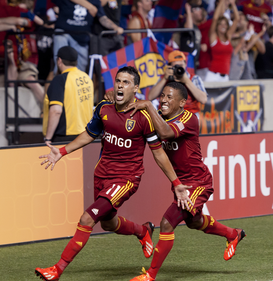 Real Salt Lake midfielder JAVIER MORALES (11) screams in jubilation with teammate JOAO PLATA (8), right, after scoring on a penalty kick in stoppage time during their MLS match against the Philadelphia Union at Rio Tinto Stadium on Wednesday, July 3, 2013. Playing a man down, Real Salt Lake managed to score 2 second half goals to draw Philadelphia 2-2. | Photo by Michael Mangum