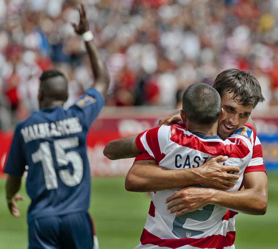 United States defender EDGAR CASTILLO (2) celebrates with forward CHRIS WONDOLOWSKI after Wondolowski put in his second goal during their CONCACAF Gold Cup match against Cuba at Rio Tinto Stadium in Sandy, Utah on Saturday, July 13, 2013. The United States defeated Cuba 4-1. | Photo by Michael Mangum