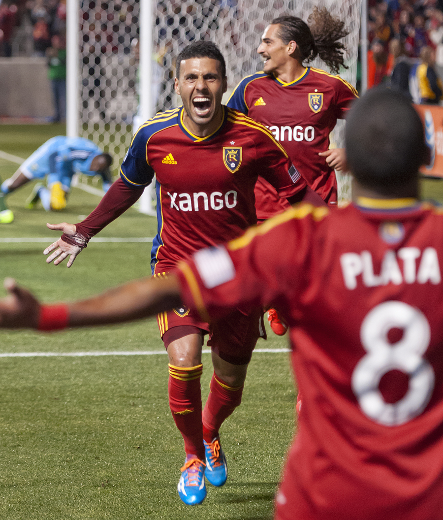 Real Salt Lake midfielder Javier Morales celebrates his headed goal and runs toward forward Joao Plata (8), who assisted the shot, with forward Devon Sandoval following behind during the first leg of their Western Conference final matchup against the Portland Timbers at Rio Tinto Stadium in Sandy, Utah on Sunday, November 10, 2013. Real Salt Lake defeated Portland 4-2. | Photo by Michael Mangum