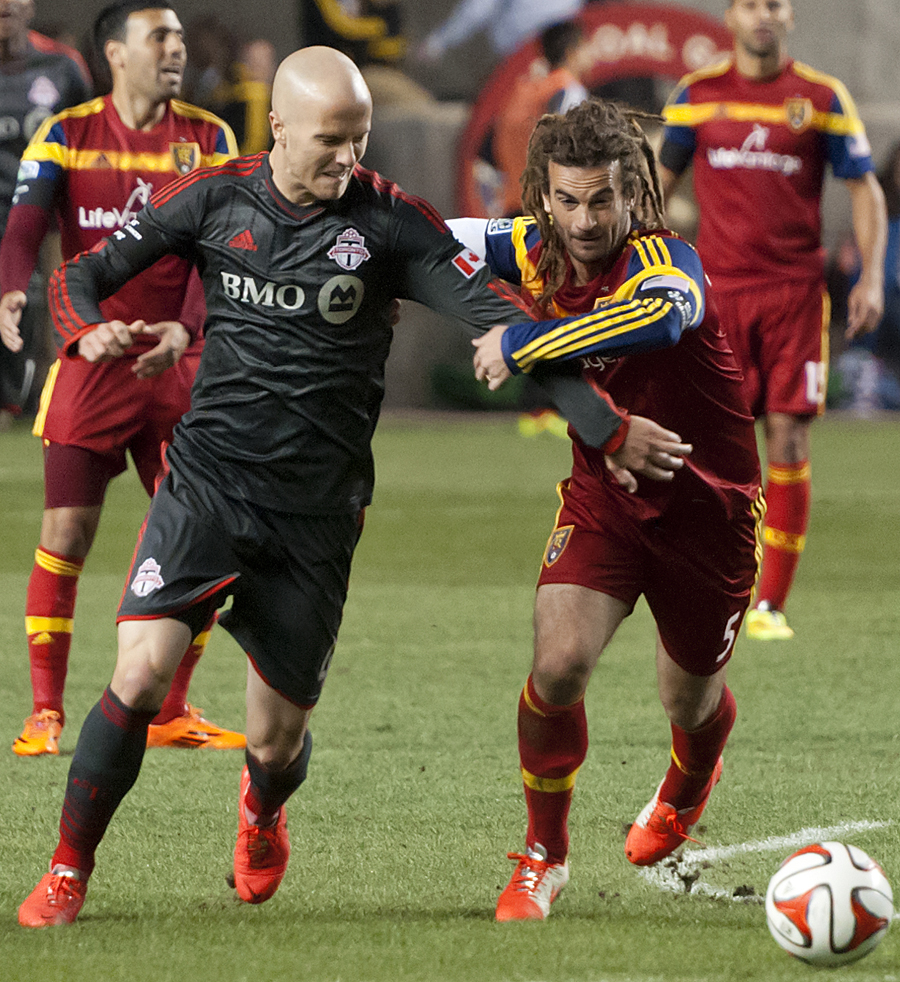 Toronto FC midfielder Michael Bradley (4) and Real Salt Lake midfielder Kyle Beckerman (5) battle for possession during their match at Rio Tinto Stadium in Sandy, UT on Saturday, March 29, 2014. Real Salt Lake defeated Toronto FC 3-0.