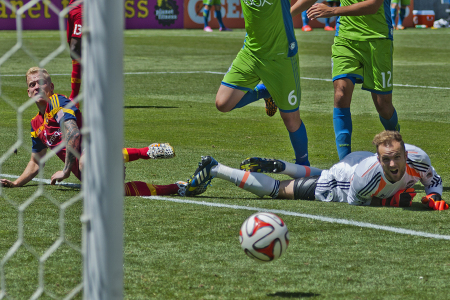 Seattle Sounders goalkeeper Stefan Frei (24) watches the ball roll past him and into the goal following a Luke Mulholland shot (on the ground, left) during the second half of their match at Rio Tinto Stadium in Sandy, UT on Saturday, August 16, 2014.  Michael Mangum  |  ChangingMyLens.com