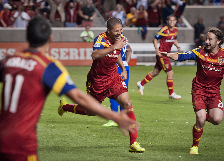 Real Salt Lake forward Alvaro Saborio (15), center, celebrates his second half goal against FC Dallas with midfielder Javier Morales (11), left, and midfielder Ned Grabavoy (20), right, during the their match at Rio Tinto Stadium in Sandy, UT on Saturday, September 6, 2014. Michael Mangum  |  ChangingMyLens.com