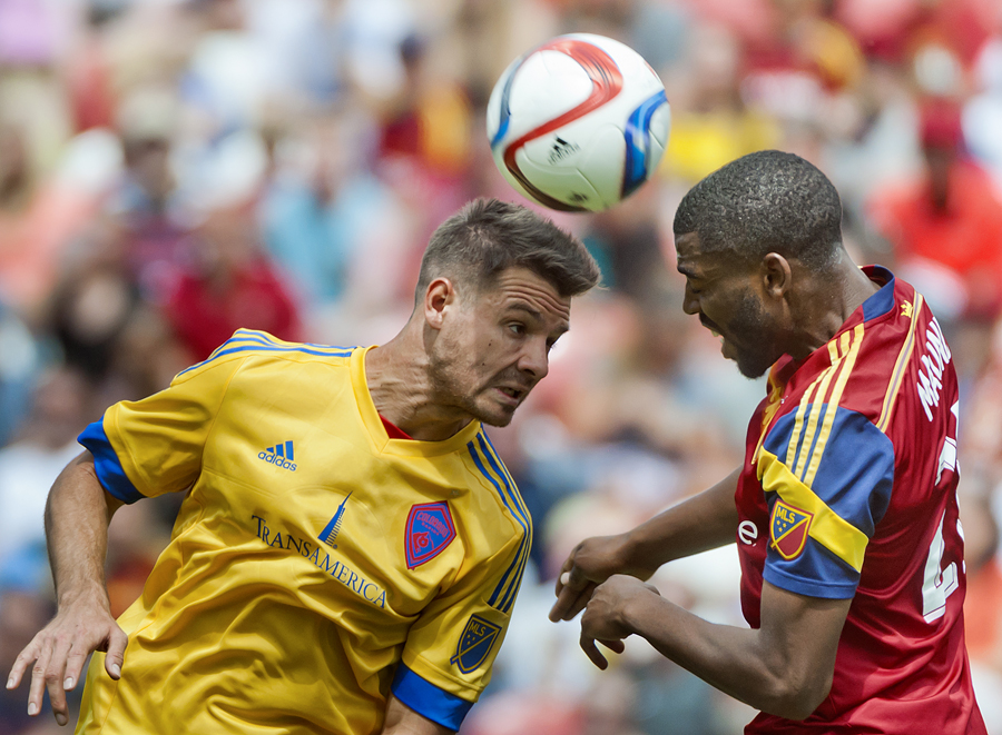 Michael Mangum  |  Special to the Tribune  |  Colorado Rapids forward Luis Solignac (21) and Real Salt Lake defender Aaron Maund (21) fly up for a header during the first half of their match at Rio Tinto Stadium on Sunday, June 7, 2015.